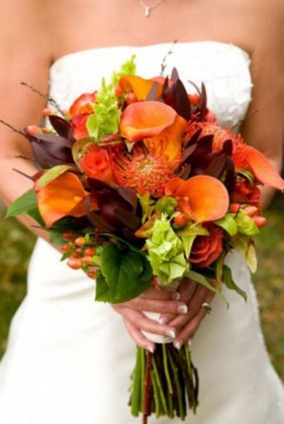 [Image: This elegant bridal bouquet is designed with cala lilies and the seasons vibrant wedding flowers. Color combinations of your choice will become our custom design.]