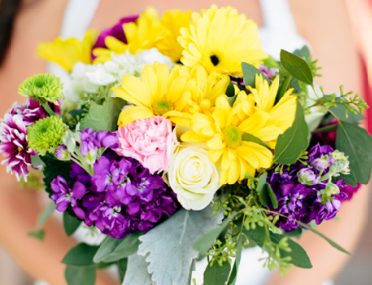 [Image: Yellow, green, and purple flowers will make a vivacious statement at your wedding! Everyone will remember your gorgeous bouquet even after the honeymoon is over.]
